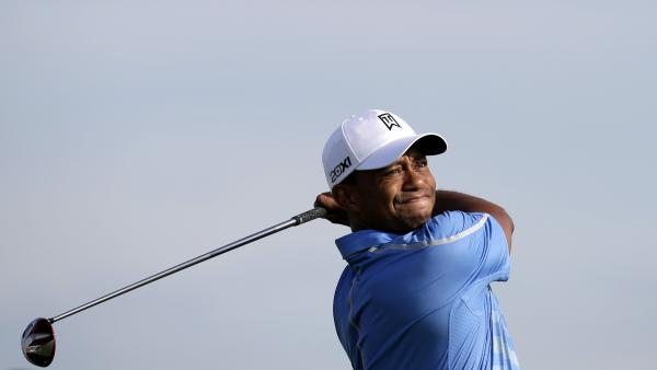 Tiger Woods watches his tee shot on the third hole during the first round of The Barclays golf tournament on Thursday.