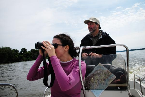 Bryan Watts, a conservation biologist at the College of William and Mary, and biology graduate student Courtney Turrin, survey eagle behavior along the James River in late-summer.