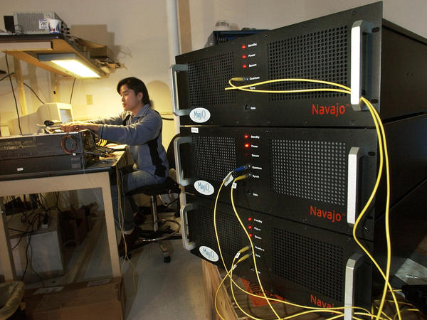 Navajo encryption boxes seen at right in 2003 employ principles of quantum physics. The latest research has shown the ability to run larger networks with less such hardware.