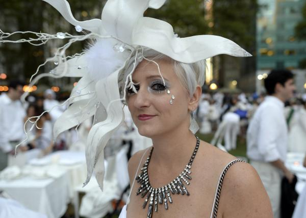 Many guests see Diner en Blanc as an occasion to unleash their fashion whimsy. The event is always held outdoors, always at a landmark location revealed at the last-minute. Here, a guest at the Bryant Park event last week.