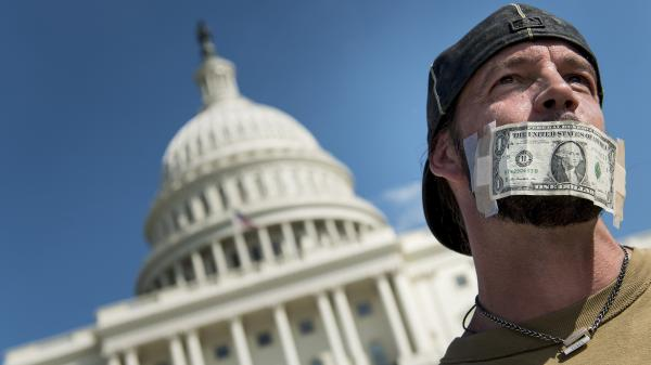 John Zangas, a furloughed federal worker, protests the government shutdown outside the U.S. Capitol on Wednesday.