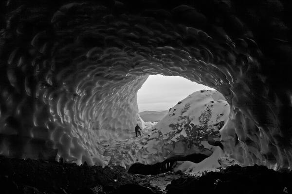 A scene from another world: entering a glacier cave on Mount Hood. Two explorers say they have mapped more than a mile of caves in Sandy Glacier.