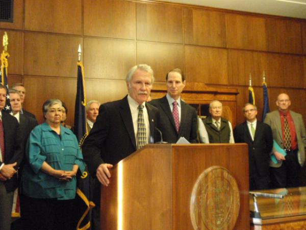 Oregon Governor John Kitzhaber introduces U.S. Senator Ron Wyden during a press conference at the Oregon capitol Tuesday.