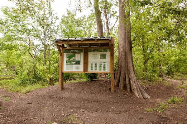 Woodlands Conservancy has interpretive kiosks and directional signage.