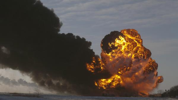 A fireball goes up at the site of an oil train derailment in Casselton, N.D., in December.