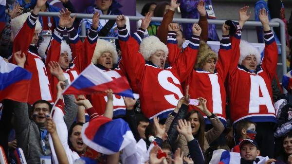 Hockey fans cheer for Russia during the men's game against Slovenia on Thursday.