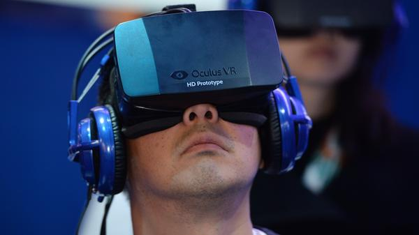 An attendee wears an Oculus Rift HD virtual reality headset at the International Consumer Electronics Show in Las Vegas.