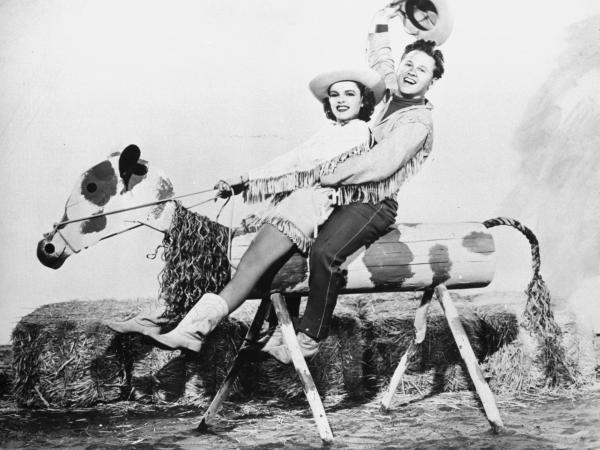 Mickey Rooney starred with Judy Garland in the 1943 movie musical <em>Girl Crazy.</em> The duo's onscreen chemistry reflected their off-screen friendship.