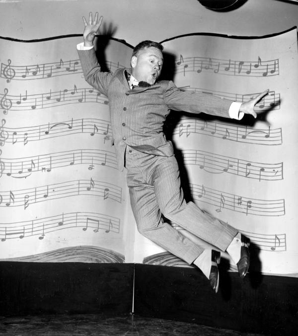 Rooney performs a dance routine during rehearsal for the television movie <em>Mr. Broadway</em> in 1957. While Rooney grew older, he never grew taller, which prevented him from being cast as a leading man. Facing mounting financial problems, he took a number of smaller parts during the 1950s and '60s.