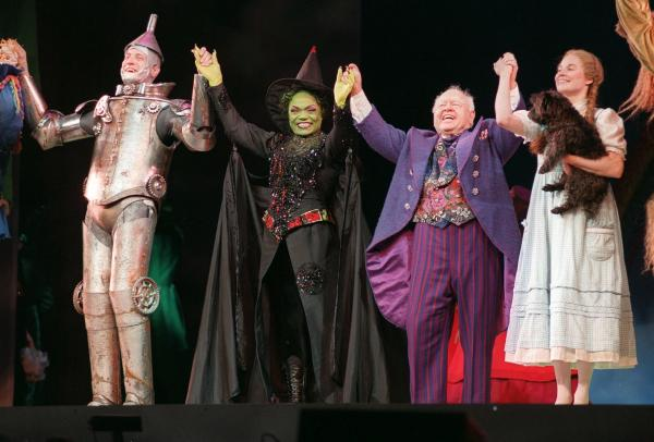 Rooney joins cast members Dirk Lumbard (left), Eartha Kitt and Caroline McMahon during the opening performance curtain call for <em>The Wizard of Oz</em> in 1998, at New York's Madison Square Garden. Rooney played the lead role in the stage production.