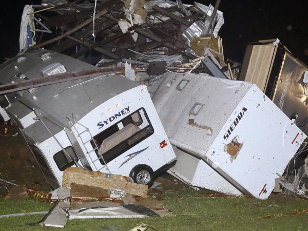 Travel trailers and motor homes were piled on top of each other at Mayflower RV in Mayflower, Ark., on Sunday after tornadoes carved through the central and southern U.S.