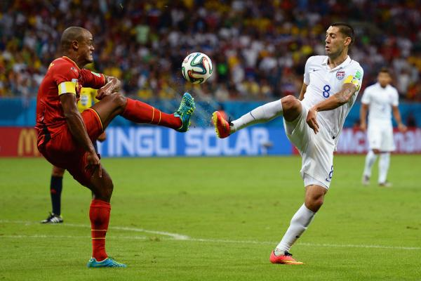 Belgium's Vincent Kompany (left) and the United States' Clint Dempsey compete for the ball.
