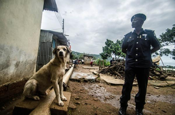 When Sule Koroma's sister Saudatu died of Ebola, his house in Freetown was put under a 21-day quarantine. The government sent two policeman to guard the house.