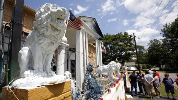 Visitors line up on Tuesday to see the eclectic collection of photos, records, albums and knickknacks collected by Paul MacLeod, an Elvis superfan who turned his Holly Springs, Miss., home into the offbeat museum called Graceland Too.