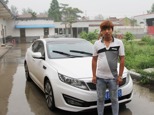 """Handsome Zhang — that's his real name in Mandarin --€"""" runs a shipping company, one of many supporting businesses spawned by East Wind village's furniture industry. The shipping business helped Zhang, 25, buy this Kia sports car."""