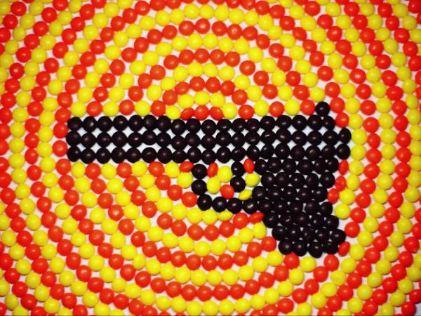 """A still from the video for """"Blood On Your Bootheels,"""" by Caroline Rose. Rose made the stop-motion animation with Skittles."""
