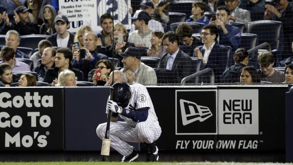 Jeter waits to bat in the first inning.