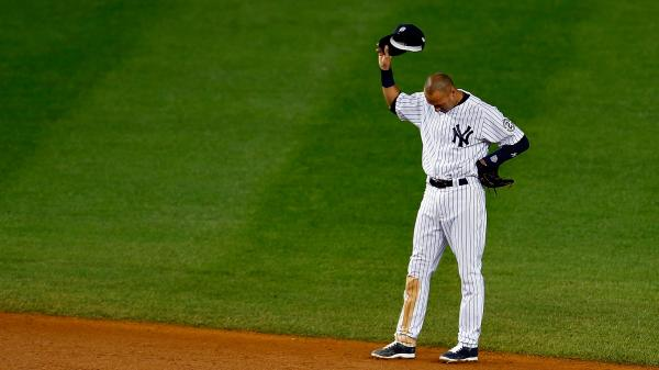 Jeter gestures to fans from the field during his last home game.
