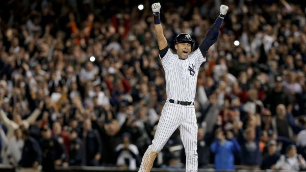 Jeter jumps after hitting the game-winning single in the bottom of the ninth, clinching his 1,627th regular-season victory with the team.