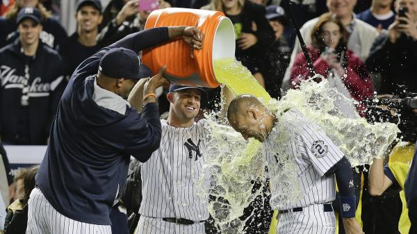 New York Yankees C.C. Sabathia (left) and Brett Gardner douse Derek Jeter with Gatorade after Jeter drove in the winning run against the Baltimore Orioles on Thursday in the final home game of his career. The shortstop is retiring after 20 seasons with the Yankees.