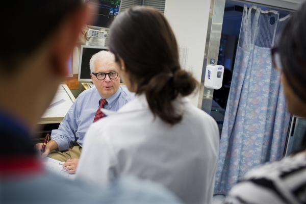 Dr. Allan Ropper speaks with residents and fellows as they do rounds at the neuroscience intensive care unit at Brigham and Women's Hospital in Boston.