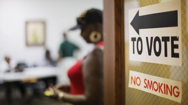 "A sign directs voters at a polling site in Atlanta. ""Georgia is changing dramatically,"" Democratic gubernatorial candidate Jason Carter says. ""There's no doubt that Georgia is next in line as a national battleground state."""