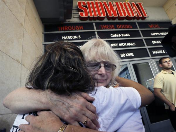 Longtime employees hug as they leave the Showboat Casino Hotel on Aug. 31, the day it closed.