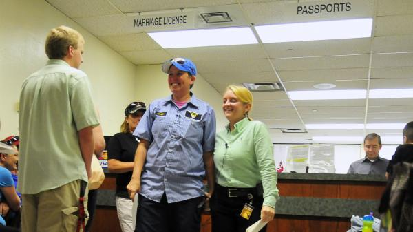 Jennifer Hasler (left) and Karina Tittjung smile after picking up their marriage license at the Oklahoma County courthouse in Oklahoma City Monday. When the U.S. Supreme Court declined to take up the issue of gay marriage, it opened the door for gay men and women to marry in 11 states, including Virginia, Oklahoma, Utah, Wisconsin and Indiana.