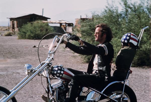 "Peter Fonda rides the ""Captain America"" chopper in <em>Easy Rider</em>."