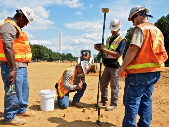 Guided by artist instructions and satellite coordinates, workers mapped out patterns in the soil not far from the Washington Monument.
