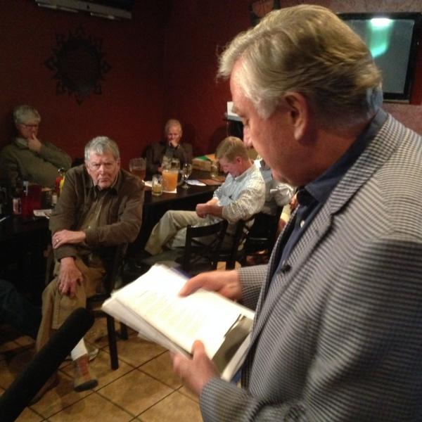 Independent candidate Larry Pressler reads at the regular meeting of a poetry club in Sioux Falls, S.D.