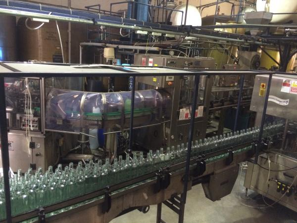 Bottles lined up at the Thames Distillery in London, waiting to be filled.
