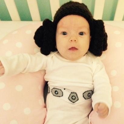 "Evelyn FitzGerald, 2 months old, is in a Princess Leia — of <em>Star Wars </em>renown — costume made from recycled clothes by her mother Shenandoah Brettell of El Segundo, Calif. ""I made the wig out of yarn and the belt out of felt,"" says Shenandoah, who listens to NPR member station KPCC."