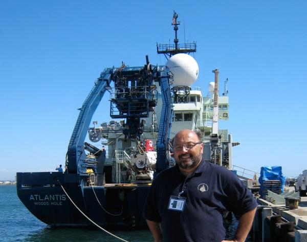 David Gallo is pictured with R/V Atlantis behind him. (Woods Hole Oceanographic Institution)