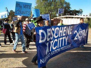 Supporters of Navajo presidential candidate Chris Deschene gather outside an administrative court in Window Rock, Ariz. Questions about his fluency in the Navajo language have dogged his campaign.