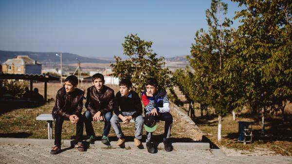 Young Crimean Tatars in the small village of Bakhchysarai are members of a Muslim minority that was long persecuted by the Soviet Union. Many Tatars are concerned now that Moscow is once again in control.