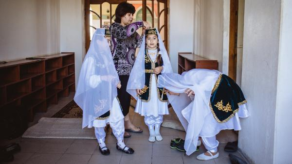 Young girls dressed in traditional Tatar outfits celebrate the Muslim holiday of Eid al-Adha.
