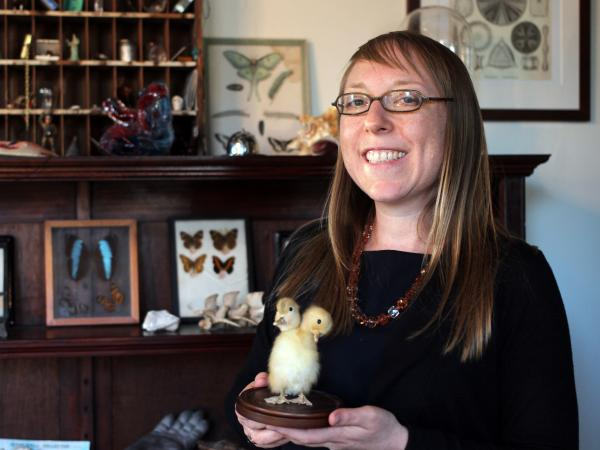Joanna Ebenstein, founder of the Morbid Anatomy Museum, with a taxidermy two-headed duckling.