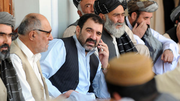 <p>The assassination of Ahmed Wali Karzai (center, shown in 2009), the half-brother of Afghan President Hamid Karzai, prompted fears of a security breakdown in the southern Afghan city of Kandahar. Ahmed Wali Karzai was rumored to have a hand in everything that went on in the region: tribal affairs, politics and business.</p>