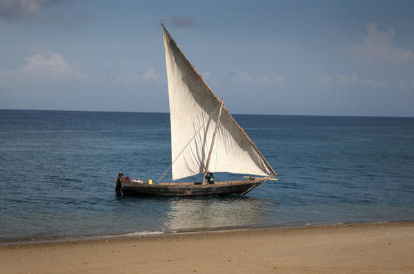 A traditional arabic Dhow sails in the Indian Ocean off the coast of Zanzibar, Tanzania.