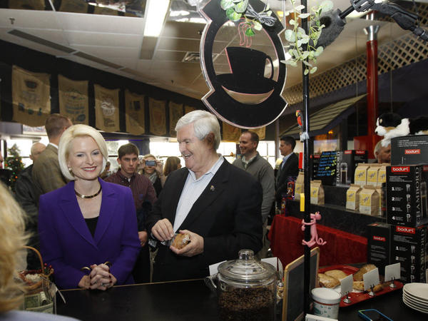 Former House Speaker Newt Gingrich heads for a caffeine fix with his wife Callista at Jitters Coffee Bar as he makes a campaign stop at the Southbridge Mall in Mason City, Iowa on Dec. 28.