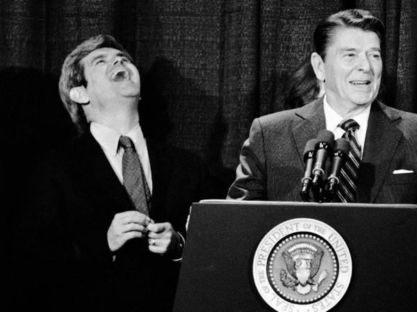 Then a congressman from Georgia, Newt Gingrich laughs at a joke told by President Reagan in Atlanta in 1984.