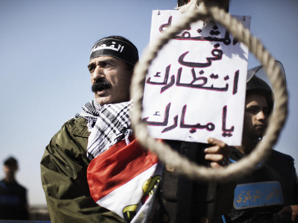 Outside the court in Cairo where former Egyptian President Hosni Mubarak has been on trial, a man earlier today held a sign saying there was a noose waiting for Mubarak.