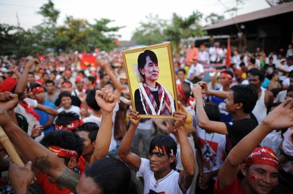 A man holds a portrait of Myanmar opposition leader Aung San Suu Kyi during a rally for a candidate of her National League for Democracy party on Friday. The country is holding elections for some parliamentary seats on Sunday.