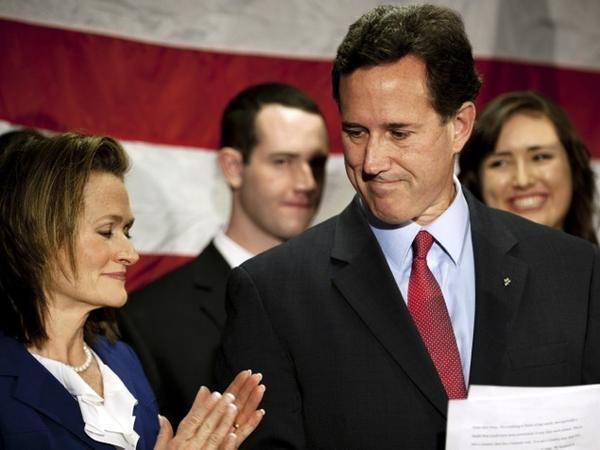 Surrounded by members of his family, Republican presidential candidate Rick Santorum announces he will suspend his campaign at the Gettysburg Hotel on Tuesday in Gettysburg, Pa.