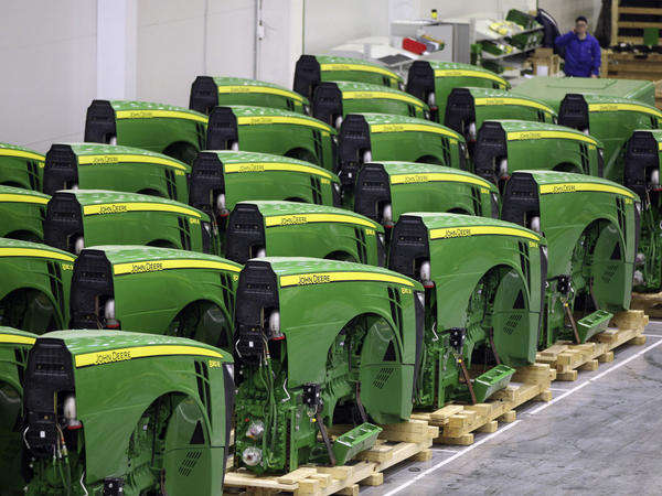 Completed front sections of John Deere tractors await further assembly inside the company's plant near Moscow.
