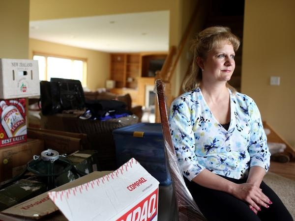 Cathy Yamauchi has been waiting since Thanksgiving to hear from her mortgage lender regarding a short sale of her home in Ramsey, Minn. She is planning to move to a townhome, but is mostly living out of boxes while waiting on the short sale.