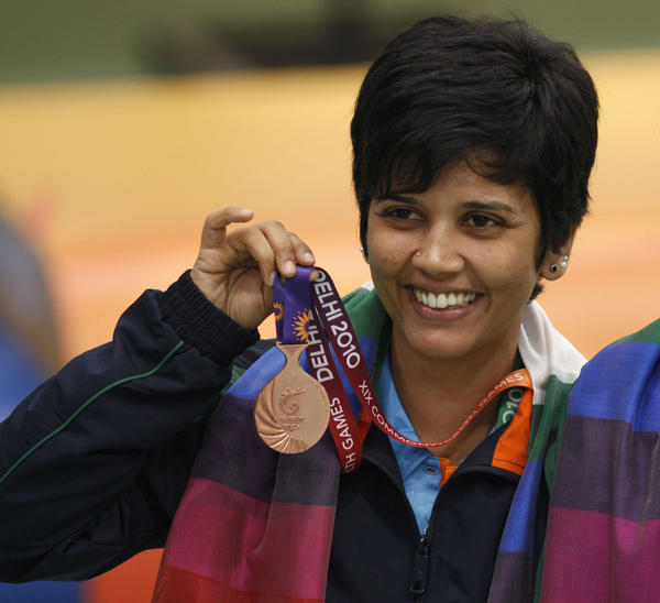 India's Suma Shirur won bronze in women's 10m air rifle pairs at the 2010 Commonwealth Games in New Delhi. She says her part-time government job gave her the time and financial stability to train for the 2004 Olympics in Athens.