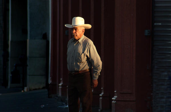 "<em>Dignified Man, </em>2006. This <em>""viejo""</em> (old one) walks on this street every evening. 6th and El Paso St. This is the first street in the U.S. after crossing from Juarez into downtown El Paso. In essence, this is the first block of America (or the last, depending on which direction you're going)."