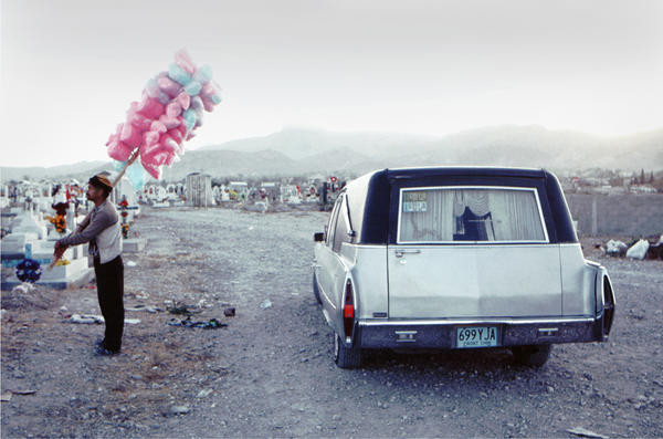 <em>Candyman in El Panteon</em>. The Panteon of Juarez (the municipal cemetery) on the Day of the Dead, 1994. The celebration is still honored, but there have been so many funerals in Juarez during the cartel war years that people are closer to death than is comfortable.